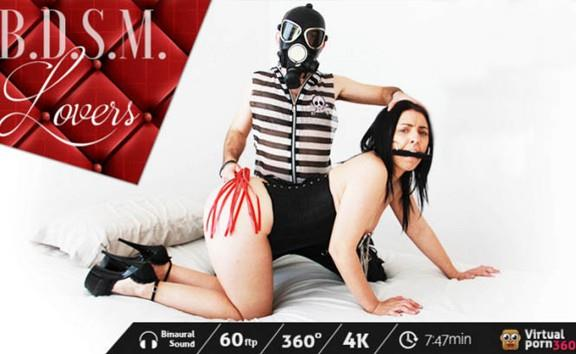 BDSM lovers: tied up and submissive woman
